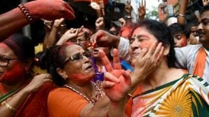 BJP supporters celebrates BJP's impressive showing in West Bengal during lok sabha election counting near BJP headquarters in Kolkata on May 23, 2019. (Arijit Sen/HT)