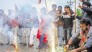 BJP workers burst crackers and dance while celebrating the party's win in the 2019 Lok Sabha elections in Srinagar on Thursday.(ANI PHOTO)