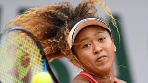 Japan's Naomi Osaka returns the ball to Madison Keys of the US during their women's singles third round match.(AFP)