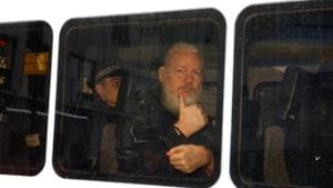 FILE PHOTO: WikiLeaks founder Julian Assange is seen in a police van after was arrested by British police outside the Ecuadorian embassy in London, Britain April 11, 2019. REUTERS/Henry Nicholls/File Photo(REUTERS)