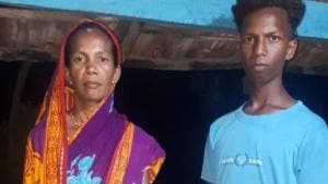 The tribal anganwadi worker in Malkangiri is seen here with her son.
