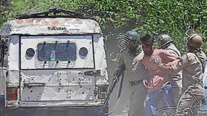 Indian policemen detain a Kashmiri youth who was protesting against the killing of Zakir Musa, a top militant commander linked to al-Qaida, in Srinagar(AP)