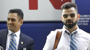 Indian cricket team captain Virat Kohli, right, and MS Dhoni arrive at the hotel in London(AP)