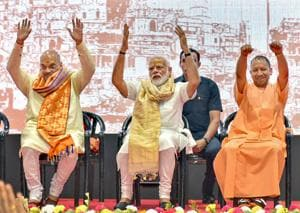 Prime Minister Narendra Modi with BJP President Amit Shah and UP chief minister Yogi Adityanath during a meeting with the party workers at Deen Dayal Upadhyay Hastkala Sankul in Varanasi, Monday, May 27, 2019.(PTI)