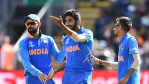 India's Jasprit Bumrah (C) celebrates with India's captain Virat Kohli (L) and teammates after taking the wicket of Bangladesh's Soumya Sarkar for 25 during the 2019 Cricket World Cup warm up match between Bangladesh v India at Sophia Gardens stadium in Cardiff, south Wales, on May 28, 2019(AFP)