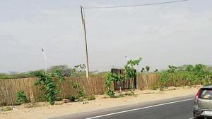 The power line crosses the Gurgaon-Faridabad highway.(HT Photo)