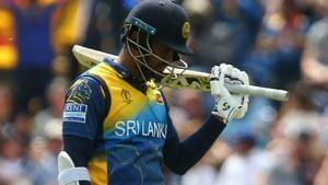 Sri Lanka's captain Dimuth Karunaratne celebrates after scoring a half-century.(AFP)