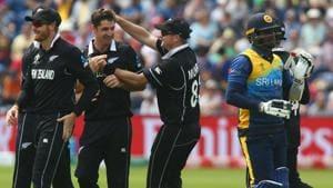 New Zealand's Colin de Grandhomme (2L) celebrates with teammates including New Zealand's Martin Guptill (L).(AFP)
