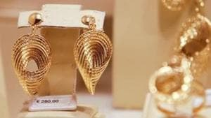 The precious metal strengthened on the back of buying by local jewellers and positive global cues(Reuters)