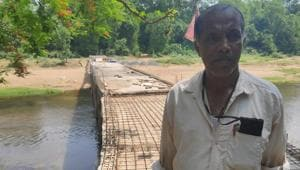 For much of his life, the lack of a bridge across the river near his village rankled Gangadhar Rout, a retired livestock inspector.(HT Photo)