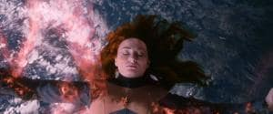 Sophie Turner plays the flame-haired Jean Grey, who slams into a solar flare while on a space mission and is transformed into a malevolent force — the Dark Phoenix.
