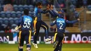 Sri Lanka's Nuwan Pradeep (2L) celebrates with team mates after taking the wicket of Afghanistan's Rashid Khan(AFP)