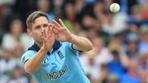 England's Chris Woakes receives the ball during the 2019 Cricket World Cup group stage match between England and Pakistan(AFP)