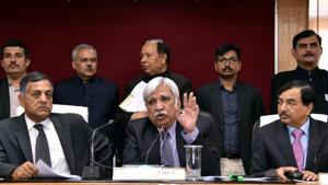 Chief Election Commissioner (C) Sunil Arora with Election Commissioner Ashok Lavasa (L) and CBDT Chairman Sushil Chandra (R) addressing a press conference in Lucknow.(ANI/ File photo)