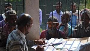 People wait to check their names on the first draft of the National Register of Citizens (NRC) at Goroimari of Kamrup district in the Indian state of Assam on January 1, 2018. Image used for representational purpose.(AFP/ File photo)