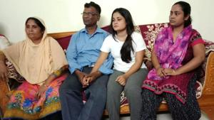 Mohammad Sanaullah (in blue shirt) with his wife Sanima Begun (extreme left) and two daughters at his home in Guwahati after his release from detention camp on Saturday.((HT Photo))