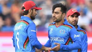 File image of Afghanistan's Rashid Khan celebrating a wicket with teammates.(AFP)