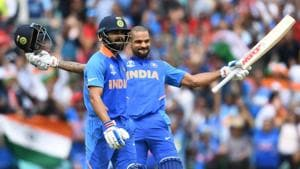 India's Shikhar Dhawan (R) celebrates after scoring a century (100 runs) alongside India's captain Virat Kohliduring the 2019 Cricket World Cup group stage match between India and Australia at The Oval in London on June 9, 2019(AFP)