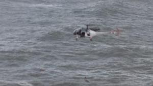 A 26-year-old army officer who slipped off the rocks and fell into the choppy sea was rescued by a coast guard helicopter on Thursday(Coast Guard)