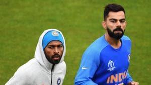 India's captain Virat Kohli (R) and India's Hardik Pandya attend a training session.(AFP)