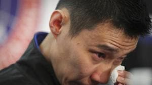 Malaysian badminton player Lee Chong Wei wipes his tears during a press conference in Putrajaya, Malaysia, Thursday, June 13, 2019. Former World No. 1-ranked Lee has announced his retirement from badminton after 19 years following his battle with cancer.(AP)