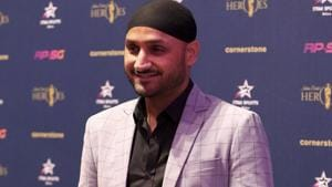 Indian cricketer Harbhajan Singh poses as he arrives for an Indian Cricket Heroes red carpet event.(AP)