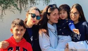 Kareena Kapoor and Krism are all smiles as they pose for a family picture in London.(Instagram)