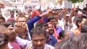 "Protestors gathered outside the SKMCH shouted, ""Nitish Kumar wapas jao (go back)"".(ANI Photo)"