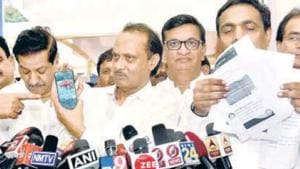 (From left) Congress' Prithviraj Chavan, NCP's Ajit Pawar with Congress leader Balasaheb Thorat and NCP leader Jayant Patil showing the tweets on the Maharashtra budget.(ANSHUMAN POYREKAR/HT PHOTO)