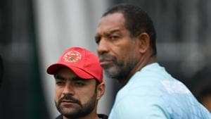 Afghanistan's Rashid Khan (L) and Afghanistan's head coach Phil Simmons (R) attend a training session.(AFP)