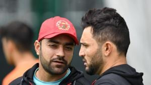 Afghanistan's Rashid Khan (L) talks with Afghanistan's captain Gulbadin Naib (R) during a training session.(AFP)