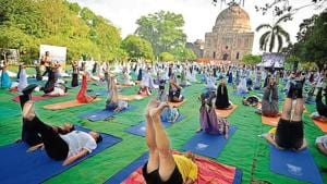 In several parts of the city, government officials, students, senior citizens and women celebrated yoga day by collectively performing asanas (poses).(HT Photo)