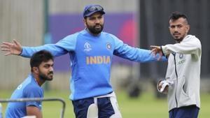 India's Rohit Sharma interacts with teammates Yuzvendra Chahal, right, and Vijay Shankar(AP)