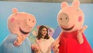 Soha Ali Khan poses with popular cartoon characters, Peppa Pig and George.