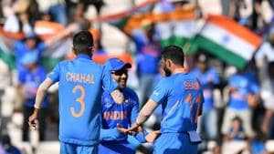 India's Mohammed Shami (R) celebrates with teammates Rohit Sharma (C) and Yuzvendra Chahal (L) after his hat-trick and victory in the 2019 Cricket World Cup group stage match between India and Afghanistan at the Rose Bowl in Southampton, southern England, on June 22, 2019(AFP)
