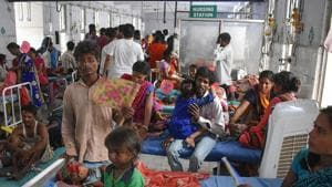 In this file photo, Indian children suffering from Acute Encephalitis Syndrome (AES) are surrounded by relatives as they are treated at the government-run Sri Krishna Medical College and Hospital in Muzaffarpur district in the eastern state of Bihar. (Photo by STR / AFP)