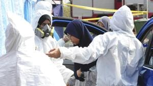 Emergency personnel help a student as she arrives at an evacuation center at Pasir Gudang district in Johor state, Malaysia, Tuesday, June 25, 2019.(AP)