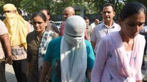 Delhi Police said the murders were committed for robbery and they are interrogating the couple to ascertain what they stole from the house.The arrested woman is the daughter of a friend of the slain elderly woman.(Sanchit Khanna/HT PHOTO)