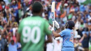 India's Rohit Sharma throws his bat in air to celebrate his century against Bangladesh.(AP)