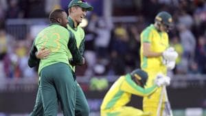 South Africa's Andile Phehlukwayo, left, celebrates with teammate Dwaine Pretorius after beating Australia.(AP)