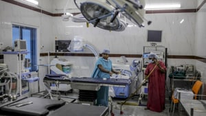 A worker mops the operation theater at a Sudar hospital in Chennai.(Dhiraj Singh/Bloomberg)