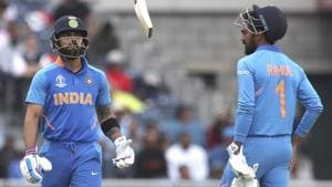 India's captain Virat Kohli, left, throws his bat in frustration after being dismissed by New Zealand's Trent Boult.(AP)