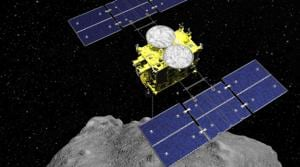 FILE - This computer graphics image released by the Japan Aerospace Exploration Agency (JAXA) shows the Hayabusa2 spacecraft above the asteroid Ryugu. Japan's space agency JAXA said Thursday, July 11, 2019 that data transmitted from the Hayabusa2 indicated its second successful touchdown on the distant asteroid to complete a historic mission - to collect underground samples in hopes of finding clues to the origin of the solar system. (ISAS/JAXA via AP)(AP)