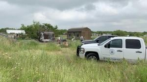 This May 20, 2019 photo provided by the Johnson County Sheriff's Office shows a medical examiners truck on the property of Freddie Mack's home in Venus, Texas. Authorities said Tuesday, July 9 thatthe 57-year-old Mack, who had been missing for months, was eaten, bones and all, by his dogs. Johnson County Sheriff Adam King says Mack had serious health problems and it's unclear whether his 18 dogs killed him or consumed his body after he died from a medical condition. A relative reported Mack missing in May.(AP)