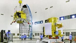 In this picture released by ISRO, officials carry out the hoisting of the Vikram Lander during the integration of Chandrayaan-2, at the launch center in Sriharikota. The space mission, which aims to place a robotic rover on the moon, is set to be launched on July 15, 2019. (ISRO/PTI Photo)