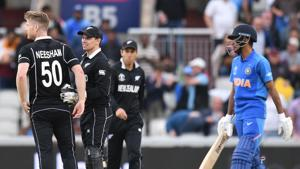 New Zealand's James Neesham (L) celebrates with New Zealand's Tom Latham after taking the final wicket of India's Yuzvendra Chahal and winning the 2019 Cricket World Cup first semi-final between New Zealand and India at Old Trafford in Manchester, northwest England, on July 10, 2019. (Photo by Oli SCARFF / AFP) / RESTRICTED TO EDITORIAL USE(AFP)