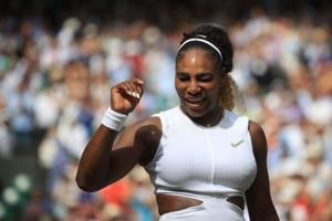 Serena Williams celebrates after beating Czech Republic's Barbora Strycova during their women's singles semi-final match at Wimbledon .(AFP)