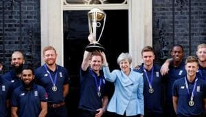 England's Eoin Morgan and Britain's Prime Minister Theresa May lift the trophy as they pose with the team outside number 10(REUTERS)