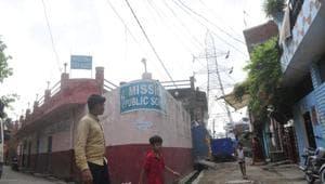 High-tension wires passing over a school building in Ashraf Nagar area of Rajajipuram, Lucknow.(Deepak Gupta/ HT Photo)