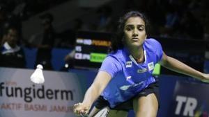 Sindhu Pusarla of India returns a shot to Nozomi Okuhara of Japan.(AP)
